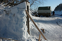 The snow outhouse and musher's tent at Eagle Island checkpoint. Photo by Jon Little.