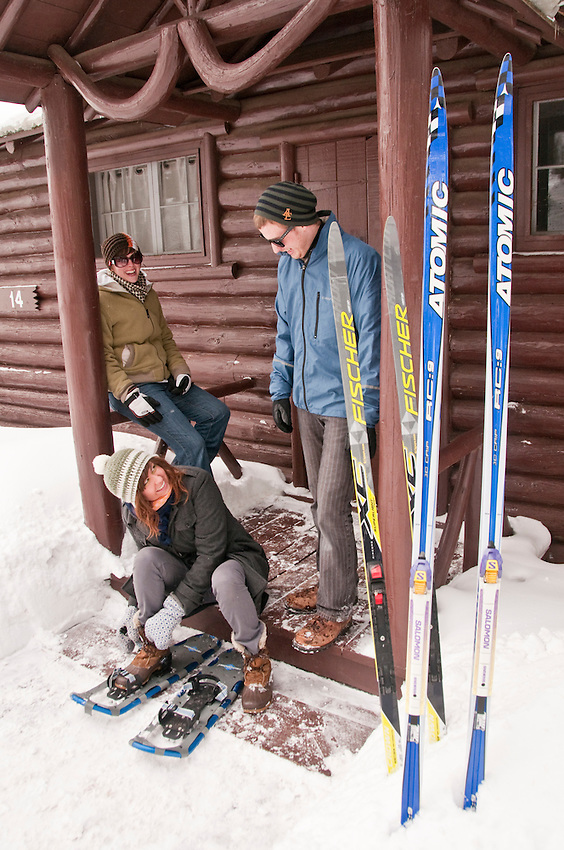 A group prepares for skiing and snowshoeing at the Keweenaw Mountain Lodge in Copper Harbor Michigan in winter.