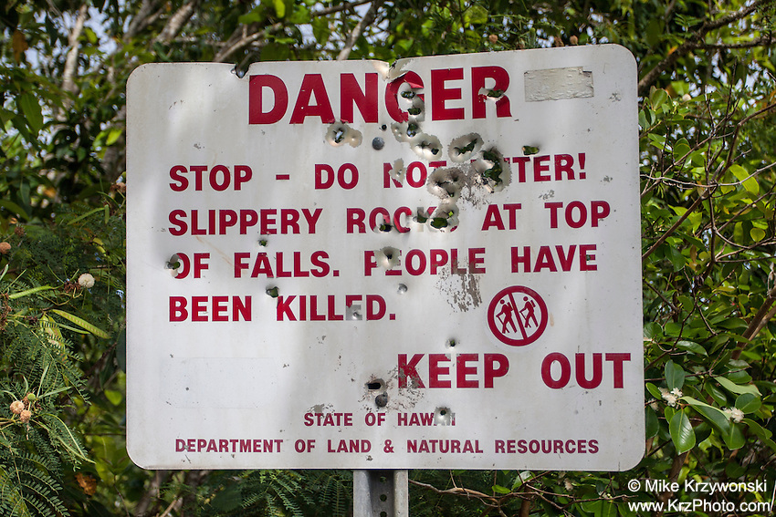 Danger sign w/ bullet holes at Wailua Falls, Kauai