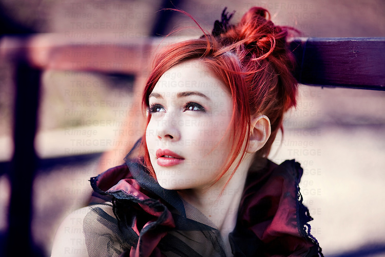 Close up of redhead dressed in Victorian style, looking away