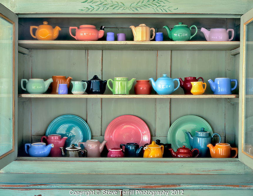 Ceramic teapots in antique cabinet