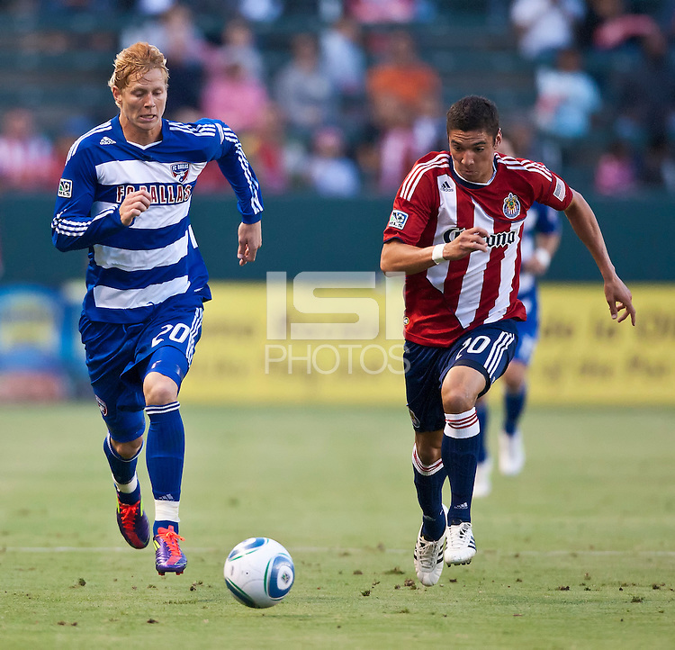 CARSON, CA – June 18, 2011: FC Dallas midfielder Brek Shea (20) and Chivas USA defender Zarek Valentin (20) during the match between Chivas USA and FC Dallas at the Home Depot Center in Carson, California. Final score Chivas USA 1, FC Dallas 2.