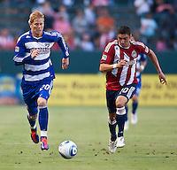 CARSON, CA – June 18, 2011: FC Dallas midfielder Brek Shea (20) and Chivas USA defender Zarek Valentin (20) during the match between Chivas USA and FC Dallas at the Home Depot Center in Carson, California. Final score Chivas USA 1, FC Dallas 2.