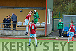 Kerry captain David Rogers wins the aerial battle with Sam McSweeney of Cobh Ramblers in the U19 Airtricity League in Mounthawk Park on Sunday