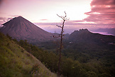 "INDONESIA, Flores, Bajawa, sunset taken from Wolobobo Hill with Mount Inerie ""Big Mama"" volcano in the distance"