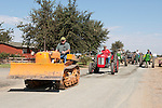 Annual fall Gas-Up at McFarland Ranch near Galt, Calif. of Branch 13, Early-Day Gas Engine and Tractor Association. (EDGE & TA)..Jim Blodget's vintage 1950 Oliver HG crawler tractor followed by a 1955 Ferguson 35 and John Deere tractors