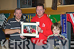 Leo Byrne (organiser) who was presented with a Liverpool photograph from Fred McDonogh (23 Foundation).