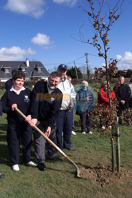 Incoming captains Raymond Dowdall and Claire Gilespie, pictured planting a tree at the Ardee golf club drive-in..pic:Arthur Carron/ Newsfile
