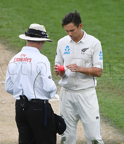 26th March 2018, Eden Park, Auckland, New Zealand; International Test Cricket, New Zealand versus England, day 5;  Trent Boult looks to change the ball with the umpire