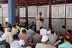Palestinians who were banned from cross to Jerusalem's al-Aqsa mosque, attend Friday prayer at the Qalandia Israeli checkpoint, betweeen Jerusalem and the West Bank city of Ramallah, May 25, 2019. The Israeli authorities reportedly banned Palestinian men under the age of 40 from entering East Jerusalem, although women were allowed in. Photo by Ayat Arqawy
