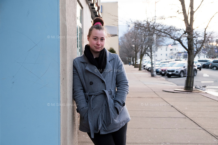 Heather Palmer, 27, of Brockton, Massachusetts, says that rumors of immigration raids have been scary for her immigrant friends. Palmer is seen here near businesses on Legion Parkway near downtown Brockton, Massachusetts, on Wed., March 29, 2017.