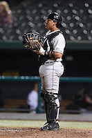 Dayton Dragons catcher Chadwick Tromp (12) warms up the pitcher in between innings during a game against the South Bend Silver Hawks on August 20, 2014 at Four Winds Field in South Bend, Indiana.  Dayton defeated South Bend 5-3.  (Mike Janes/Four Seam Images)