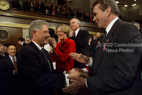 United States President Bill Clinton shakes hands with U.S. Representative Dale Kildee (Democrat of Michigan) as he enters the Joint Session of Congress for the State of the Union Address in Washington, D.C. on January 19, 1999.                                                                                              .Credit: Win McNamee / Pool via CNP