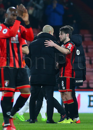 February 13th 2017, Vitality Stadium, Bournemouth, Dorset, England; EPL Premier league football, Bournemouth versus Manchester City; Harry Arter of Bournemouth receives good wishes from Manchester City Manager Pep Guardiola at full time, as Arter and his wife prepare for the birth of their child