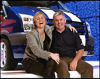 BNPS.co.uk (01202 558833)Pic: PeterLee/BNPS<br /> <br /> Transit man Peter with Transit woman Sabine Schmitz - she famously drove a Transit diesel round the N&uuml;rburgring in 10mins 8secs on Top Gear.<br /> <br /> Transit-man Peter Lee - Lifetime's collection of anything related to Britains favourite van.<br /> <br /> White van Super-Man - When it comes to motoring collections there are no shortage of impressive Ferrari and Aston Martin ensembles, but one enthusiast is laying claim to a rather different collection.<br /> <br /> Peter Lee, 68, believes he has the world's biggest Ford Transit collection and is the proud owner of over 22,000 items relating to the world's most famous van.<br /> <br /> Included among that are nine pristine vehicles that he regularly uses himself at various shows and events.<br /> <br /> He says he has no idea how much he's spent assembling the impressive collection but it is thought to be in the hundreds of thousands of pounds.
