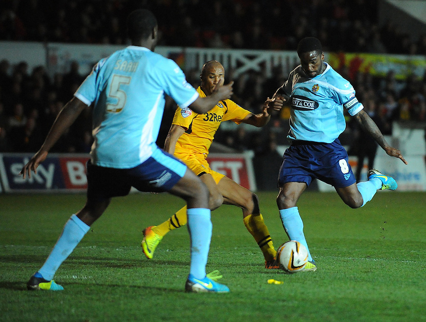 Dagenham and Redbridge's Abu Ogogo takes a shot<br /> <br /> Photo by Kevin Barnes/CameraSport<br /> <br /> Football - The Football League Sky Bet League Two - Newport County AFC v Dagenham &amp; Redbridge - Wednesday 19th March 2014 - Rodney Parade - Newport<br /> <br /> &copy; CameraSport - 43 Linden Ave. Countesthorpe. Leicester. England. LE8 5PG - Tel: +44 (0) 116 277 4147 - admin@camerasport.com - www.camerasport.com