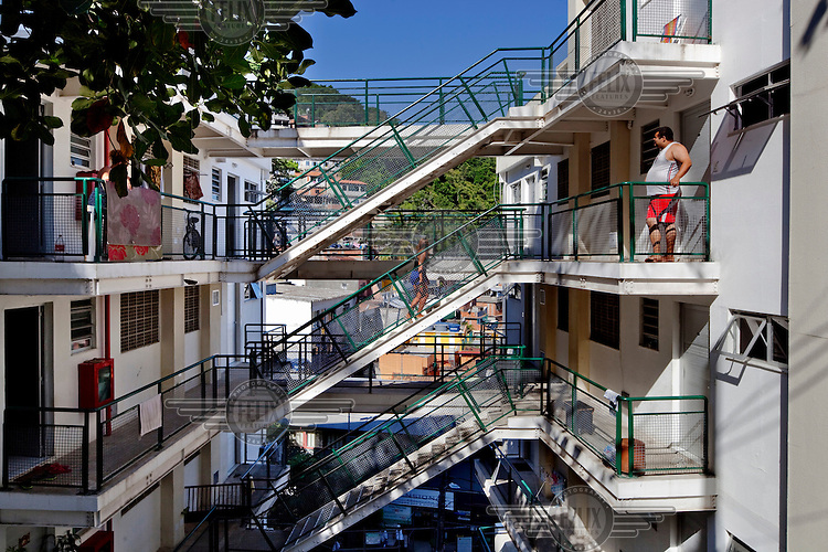 A newly built residential apartment block that was constructed for families whose homes were demolished to make way for an access road, all part of the Morar Carioca urbanising project in the Morro da Babilonia favela.
