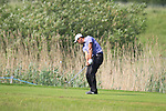 Simon Khanplaying a drop after putting his ball in the water 13th on day two of the Celtic Manor wales Open 2010.Picture Fran Caffrey/Newsfile.ie