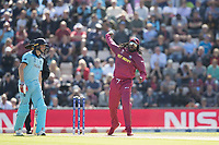 Chris Gayle (West Indies) turns his arm over complete with sunglasses and cap during England vs West Indies, ICC World Cup Cricket at the Hampshire Bowl on 14th June 2019