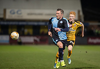 Garry Thompson of Wycombe Wanderers & Ryan Haynes of Cambridge United chase down the ball during the Sky Bet League 2 match between Cambridge United and Wycombe Wanderers at the R Costings Abbey Stadium, Cambridge, England on 1 March 2016. Photo by Andy Rowland / PRiME Media Images.