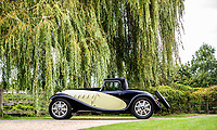 BNPS.co.uk (01202 558833)<br /> Pic: Bonhams/BNPS<br /> <br /> Former owner Jacques Dupuy commissioned Giuseppe Figoni to create the unique coachwork. <br /> <br /> A classic car bought by a British motoring enthusiast for £750 before it was nearly written off by a drunk driver has sold for £3.8m.<br />  <br /> The 1932 Bugatti Type 55 roadster belonged to the late Geoffrey St John for over 50 years until his death last February.<br /> <br /> In 1994 he was badly injured when the motor was ploughed into by a drunk driver in France.<br /> <br /> Luckily the car - then valued at about £1m - could be salvaged and repaired.