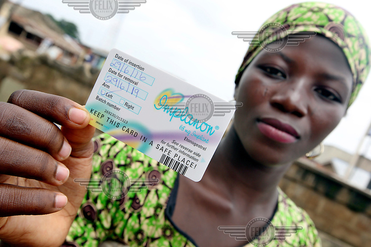 Bukola Akami, who is a mother of two children, shows her 'date of removal card' after she had an Implanon subdermal contraceptive implant during a Planned Parenthood Federation of Nigeria (PPFN) outreach programme at the Eni Ayo clinic.