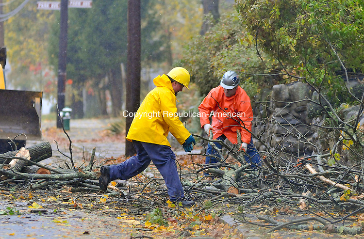 NAUGATUCK, CT-29 OCTOBER 2012--102912JS06--Utility crews clear debris after power was restored after a tree fell on wires on Millville Avenue in Naugatuck on Monday.Jim Shannon Republican-American