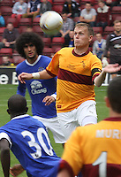 Steven Hammell wins the header in the Motherwell v Everton friendly match at Fir Park, Motherwell on 21.7.12 in his Testimonial.