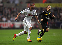 Pictured: Luke Moore of Swansea (L). Saturday 31 December 2011<br /> Re: Premier League football Swansea City FC v Tottenham Hotspur at the Liberty Stadium, south Wales.