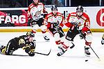 Stockholm 2014-01-08 Ishockey SHL AIK - Lule&aring; HF :  <br />  Lule&aring;s Niklas Olausson i kamp om pucken med AIK:s Oscar Ahlstr&ouml;m <br /> (Foto: Kenta J&ouml;nsson) Nyckelord: