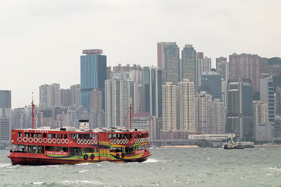 Star Ferry in Victoria Harbour below Hong Kong skyline, Hong Kong SAR, China, Asia