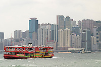Star Ferry in Victoria Harbour below Hong Kong skyline, Hong Kong SAR, China, Asia