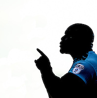 Adebayo Akinfenwa of Wycombe Wanderers in the shadow during the Sky Bet League 2 match between Grimsby Town and Wycombe Wanderers at Blundell Park, Cleethorpes, England on 4 March 2017. Photo by Andy Rowland / PRiME Media Images.