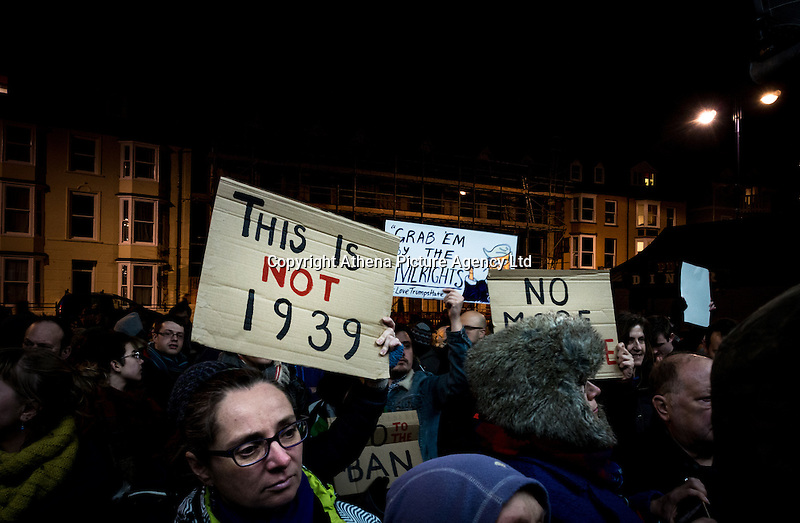 """Hundreds of people gather to show their solidarity against US President Trump's so called """"Muslim Ban"""" on Aberystwyth seafront, Wales, UK. Monday 30 January 2017"""