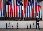 pvc053011d/5-30-11/north.  Marine Corps PFC David Dillman (CQ), of Albuquerque, who is with the 4th Reconnaissance Battalion, stands guard over seven M16 A4 rifles to be used in a 21 gun salute at the Santa Fe National Cemetery on Memorial Day Monday May 30, 2011.  (Pat Vasquez-Cunningham/Journal)