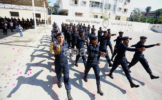 Palestinian students show off their military skills during a graduation ceremony from Ribat University College, in Gaza City, On October 16, 2017. Photo by Atia Darwish