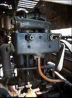 BNPS.co.uk (01202 558833)<br /> Pic: PhilYeomans/BNPS<br /> <br /> Power...2cyl 6.5hp engine.<br /> <br /> Staff at the Haynes motor museum have dusted off what is thought to be Britains first wedding car, after the remarkable discovery in New Zealand of a 110 year old wedding snap.<br /> <br /> The museum's research has unearthed the Edwardian photograph of the old Daimler at the 1903 wedding between a Mr James Andrews and Miss Rosa Gough in Weston-Super-Mare - thought to be the first time a car was used for as wedding transport in Britain.<br /> <br /> The 1897 British built Daimler Wagonette dates from the very earliest days of motoring when the phrase 'Horseless carriage' was very apt. Its rudimentary 2 cylinder petrol engine only produced 6.5hp giving a top speed of only 11.6mph. <br /> <br /> The car featured cart wheels with solid tyres, a metal rod that functioned as a 'hand' brake, leather mud flaps and cart springs...and the brakes were rubber blocks that gripped the tyres.