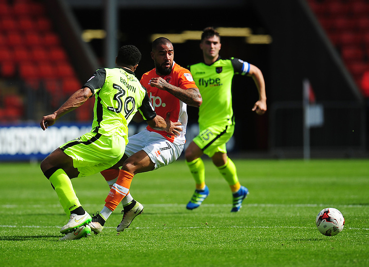 Blackpool's Kyle Vassell vies for possession with Exeter City's Troy Brown<br /> <br /> Photographer Kevin Barnes/CameraSport<br /> <br /> Football - The EFL Sky Bet League Two - Blackpool v Exeter City - Saturday 6th August 2016 - Bloomfield Road - Blackpool<br /> <br /> World Copyright © 2016 CameraSport. All rights reserved. 43 Linden Ave. Countesthorpe. Leicester. England. LE8 5PG - Tel: +44 (0) 116 277 4147 - admin@camerasport.com - www.camerasport.com
