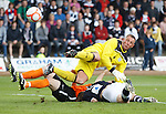 Jon Daly heads in to score for Dundee Utd as Dundee keeper Rab Douglas challenges for the ball