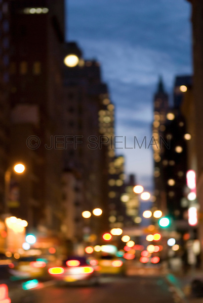 AVAILABLE FROM JEFF AS A FINE ART PRINT.<br /> <br /> AVAILABLE FROM GETTY IMAGES FOR COMMERCIAL AND EDITORIAL LICENSING.  Please go to www.gettyimages.com and search for image # 115925719.<br /> <br /> Defocused/Soft Focus Broadway Street Scene at Dusk, Lower Manhattan, New York City, New York State, USA