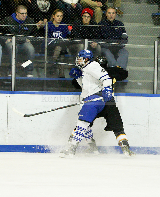 Junior forward Gray McLaughlin Checks a Missouri player into the boards during the UK men's hockey game versus Missouri at Lexington Ice Center in Lexington, Ky., on Saturday, November, 9, 2013. Photo by Jonathan Krueger | Staff