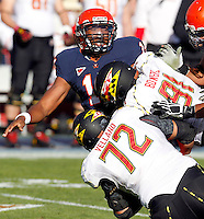 Virginia Cavaliers quarterback Phillip Sims (14) is sacked by Maryland Terrapins defensive lineman Joe Vellano (72) and Maryland Terrapins defensive lineman Keith Bowers (91) during the game at Scott Stadium in Charlottesville, VA. Photo/The Daily Progress/Andrew Shurtleff