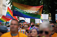 A rainbow banner held up as thousands of people take part in this year's Pride Parade in the centre of Cardiff, Wales, UK. Sayurday 26 August 2017