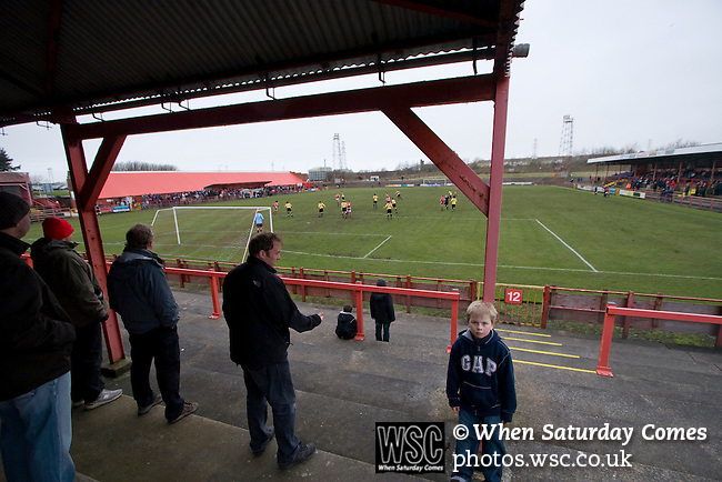 Workington AFC 0 Boston United 1, 24/02/2008. Borough Park, Blue Square North. Fans in the covered terracing watching the action during the Blue Square North fixture between hosts Workington AFC (red) and Boston United at Borough Park. The visitors won with a solitary sixth-minute goal by Jon Rowan in front of 388 spectators. Both Workington AFC and Boston United were members of the Football League, the Cumbrians losing League status in 1977 while the Lincolnshire club were relegated in 2007 and demoted two divisions for financial irregularities. Photo by Colin McPherson.