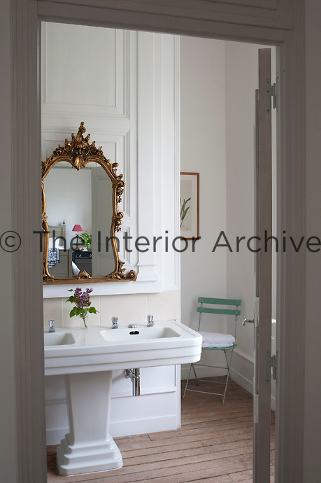The 1930s pedestal double basin in the ensuite bathroom was salvaged during the restoration