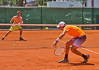 Austria, Kitzbuhel, Juli 15, 2015, Tennis, Davis Cup, Pracise Dutch team, Jean-Julien Rojer returns the ball to Robin Haase in a volley volley game<br /> Photo: Tennisimages/Henk Koster