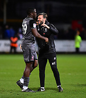 Lincoln City's John Akinde, left, celebrates the victory with Lincoln City's assistant manager Nicky Cowley<br /> <br /> Photographer Andrew Vaughan/CameraSport<br /> <br /> The EFL Sky Bet League Two - Cambridge United v Lincoln City - Saturday 29th December 2018  - Abbey Stadium - Cambridge<br /> <br /> World Copyright © 2018 CameraSport. All rights reserved. 43 Linden Ave. Countesthorpe. Leicester. England. LE8 5PG - Tel: +44 (0) 116 277 4147 - admin@camerasport.com - www.camerasport.com