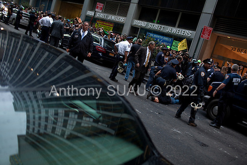 New York, New York<br /> October 14, 2011<br /> <br /> Owners of Zuccotti Park delayed a cleanup scheduled for Friday morning, averting a feared showdown between the police and the Occupy Wall Street demonstrators. <br /> <br /> Protesters, who have been occupying the park for three weeks, performed an intense clean up in the park as some held firm to stay while others appeared to be ready to move out. <br /> <br /> When the postponement was announced at 7AM the crowd surged and small bands marched towards Wall Street where the police arrested several in the crowd and the financial district became chaotic...The participants of the event, that began on September 17, are mainly protesting against social and economic inequality, corporate greed, and the influence of corporate money and lobbyists on government, among other concerns.
