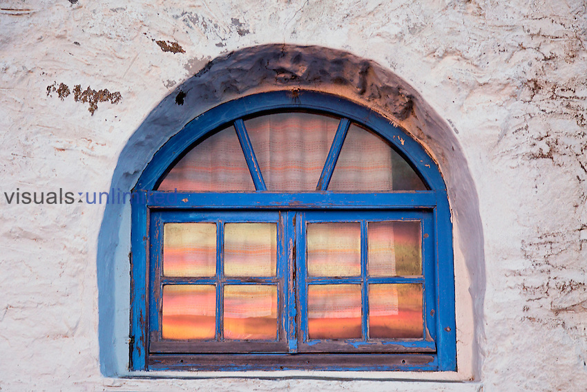 Window with sunset reflection, Mykonos, Greece
