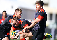 Dan Robson (Wasps) held up by (L) Jason Woodward and   (R) Owen Farrell (Saracens) during the England Rugby training session at  Jonsson Kings Park Stadium,Durban.South Africa. 05,06,2018 Photo by Steve Haag)